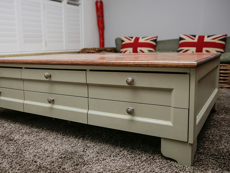 Coffee table with classic shaker style drawer panels in a handprinted finish.