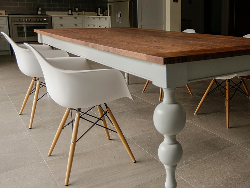 Modern classic turned leg dining room table with an aged solid Oak top.