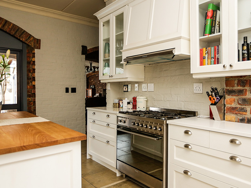 French 'provance style' kitchen Island and extractor hood view.